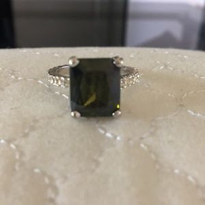 Jewelry - Ring with large green center stone. Diamond band